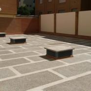 Obra de impermeabilización y solado de patio en comunidad de vecinos zona Nervión, Sevilla.